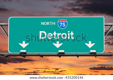 Detroit Michigan Interstate 75 north highway sign with sunrise sky. - stock photo