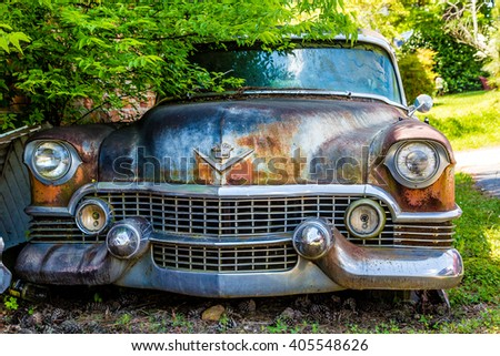 DETROIT, MICHIGAN - May 11, 2015: Wreck of a vintage Cadillac. The logo has changed, but this original was based on coat of arms for Le Sieur Antoine De La Mothe Cadillac, the man who founded Detroit - stock photo