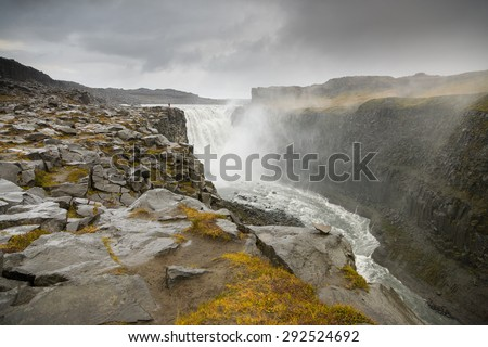 Dettifoss waterfall in Iceland showing the spray and power of the waterfall - stock photo