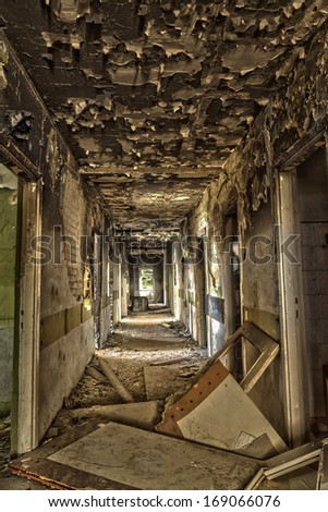 Devastated, destroyed the hotel corridor - stock photo