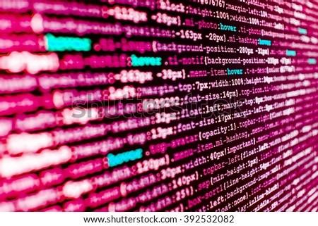 Developer working on program codes in office. Programming code.  Software background. Source code photo. Programming code on computer screen. Website development.   - stock photo