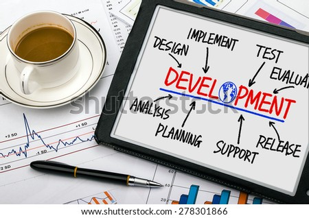development concept flowchart hand drawing on tablet pc - stock photo