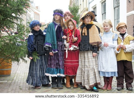DEVENTER   NETHERLANDS ; Costumed participants at the Dickens Festival on 21 december 2014.More than 950 characters from the famous books of Charles Dickens relives in Deventer  - stock photo