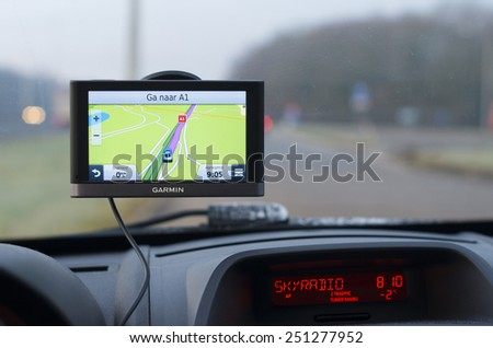 DEVENTER, NETHERLANDS - FEBRUARY 7, 2015: Garmin gps navigation device in a car. Garmin is one of the largest manufacturers of GPS devices.