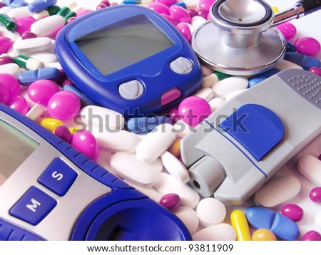 Device for measuring blood sugar level and pills with stethoscope - stock photo
