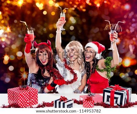 devil, angel and santa celebrating together - stock photo
