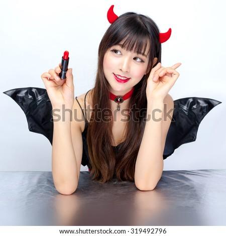 devil girl cosplay Halloween sexy make up lipstick - stock photo