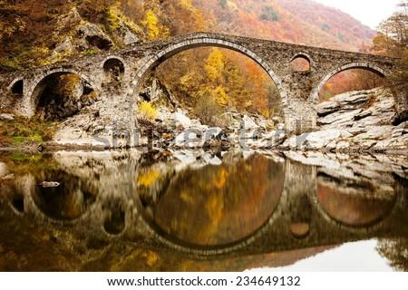 Devil's Bridge on Autunm, Silk Road, Ardino , Bulgaria - stock photo