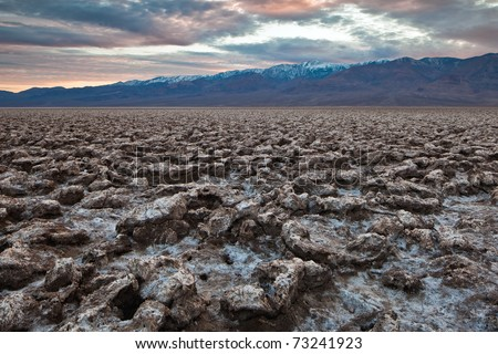 Devil's Golf Course in the Badwater Basin.  The Devil's Golf Course is a large salt pan on the floor of Death Valley in the Badwater Basin. - stock photo