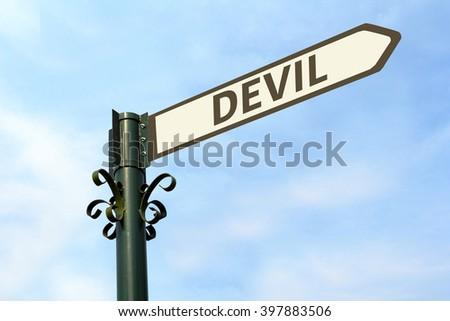 DEVIL WORD ON ROADSIGN - stock photo