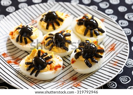 Deviled eggs with a Spider for Halloween - stock photo