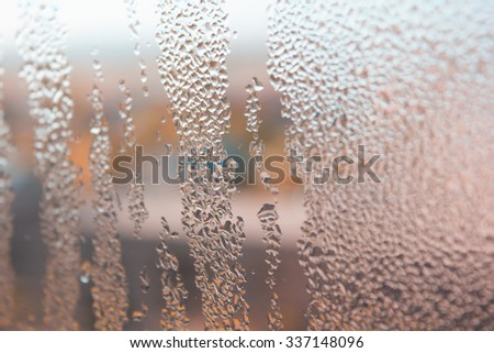 Dew drops on the window surface. - stock photo