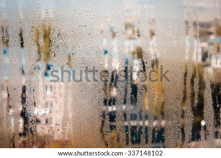 Dew drops on the window surface - stock photo