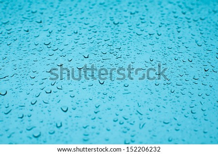 Dewdrop on blue background - stock photo