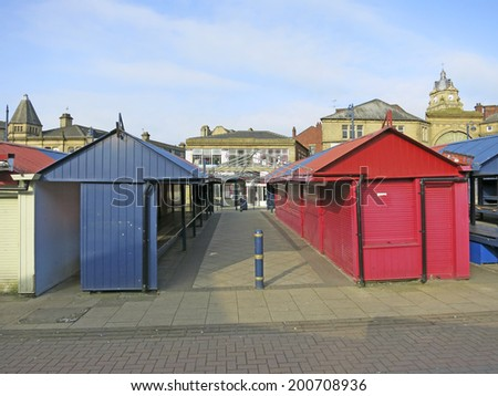 DEWSBURY, UK -JUNE 16: Market, Dewsbury, West Yorkshire, England, UK, 16 June 2014. Dewsbury, after a period of decline, is redeveloping derelict mills into flats and regenerating city areas.  - stock photo