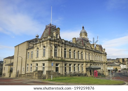 DEWSBURY, UK -JUNE 16: Town Hall, Dewsbury, West Yorkshire, England, UK, 16 June 2014. Dewsbury,  after a period of decline, is redeveloping  derelict mills into flats and regenerating city areas. - stock photo