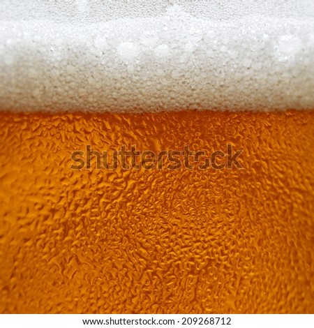 dewy beer in a glass - stock photo