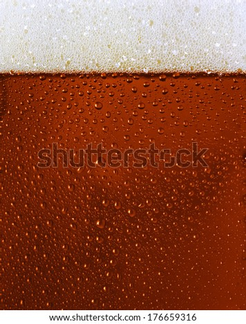 Dewy Black beer glass texture w froth - stock photo