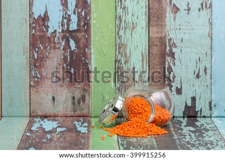 Dhal inside jar with pallet texture background. Selective focus with shallow depth of field apply. - stock photo