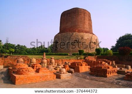 Dhamekh Stupa in Panchaytan temple ruins, Sarnath, Varanasi, India landmarks history is buddhist travel   - stock photo