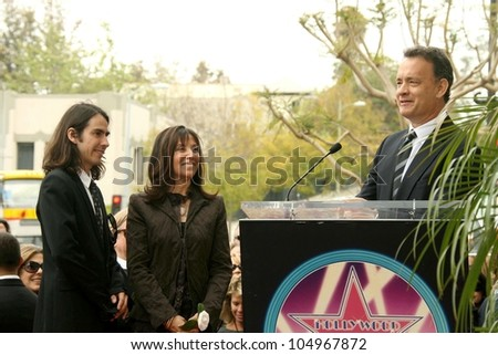 Dhani Harrison with Olivia Harrison and Tom Hanks at the ceremony posthumously honoring George Harrison with a star on the Hollywood Walk of Fame. Vine Boulevard, Hollywood, CA. 04-14-09 - stock photo