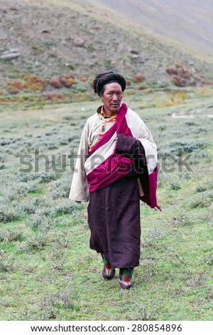 DHO TARAP, DOLPO, NEPAL - SEPTEMBER 11: Ngakpa man in traditional clothes waiting for Puja ceremony during Dho Tarap Full Moon Festival on September 11, 2011 in Dho Tarap village, Nepal. - stock photo