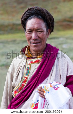 DHO TARAP, DOLPO, NEPAL - SEPTEMBER 11: Tibetan Ngakpa man in traditional clothes poses for a photo during Dho Tarap Full Moon Festival on September 11, 2011 in Dho Tarap village, Nepal.  - stock photo