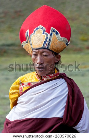 DHO TARAP, NEPAL - SEPTEMBER 11: Buddhist monk in national clothesl poses for a photo during Full Moon festival on September 10, 2011 in Dho Tarap village, Upper Dolpo, Nepal - stock photo