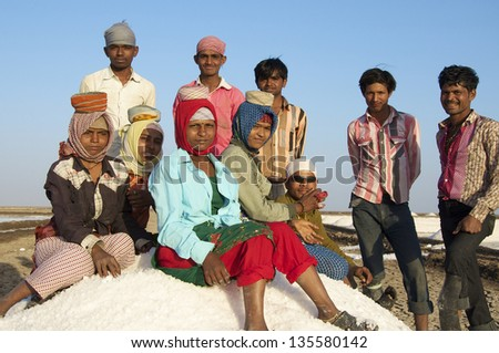 DHRANGADHRA, GUJARAT, INDIA - MARCH 13: Group of salt workers (unidentified) take a break.  On March 13, 2012 in Dhrangadhra, India.  India is world's 3rd largest producer of salt, 80% from Gujarat.