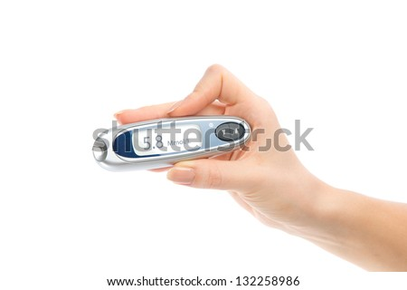 Diabetes composition glucometer in hand for measuring glucose level blood test isolated on a white background - stock photo