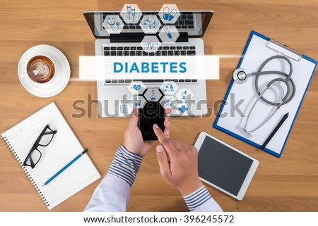DIABETES CONCEPT Doctor working at office desk and using a mobile touch screen phone, computer and medical equipment all around, top view, coffee - stock photo