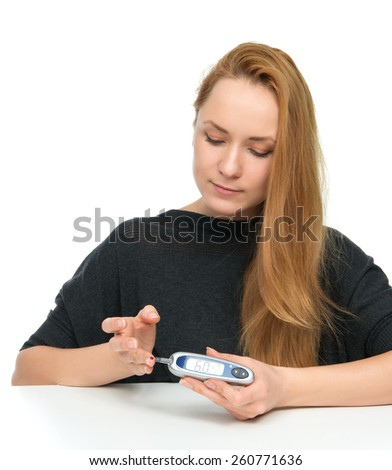Diabetes diabetic patient woman measuring glucose level blood test with glucometer before insulin injection on a white background - stock photo