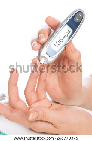 Diabetes patient measuring glucose level blood test using medical glucometer isolated on a white background - stock photo