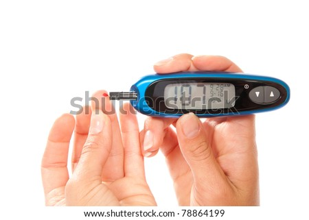 diabetes patient Measuring glucose level blood using glucometer test isolated on a white background. Low blood sugar hypoglycemia - stock photo