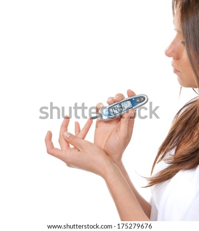Diabetes patient woman measuring glucose level blood test with glucometer on a white background - stock photo