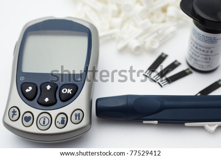 Diabetic sugar tester device kit on white background.