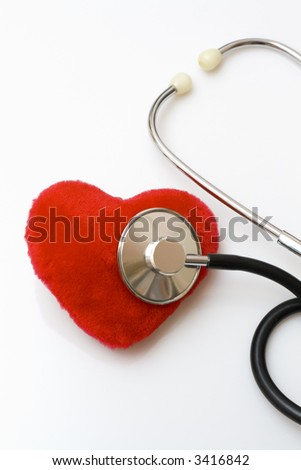 Diagnosing a red velvet heart, Stethoscope diagnosing - stock photo