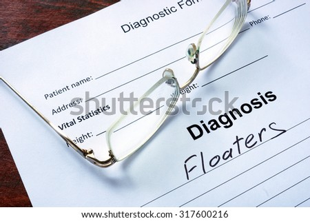Diagnosis list with Floaters and glasses. Eye disorder concept. - stock photo