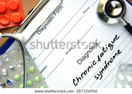 Diagnostic form with diagnosis Chronic fatigue syndrome and pills. - stock photo