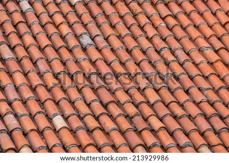 Diagonal rooftop with orange roof tiles - stock photo