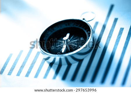 Diagram concept with compass in blue toning - stock photo