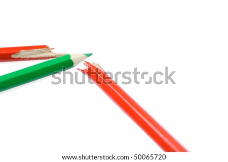 Diagram made of crayons as a stock market's suppression. Isolated on white background. Shallow depth of field with focus on end of green pencil.