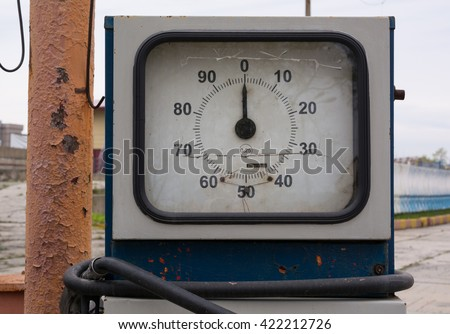 Dial of Old Gasoline Pump Close-up. It is located in an abandoned gas station. - stock photo