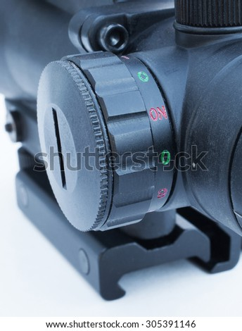 Dial that is used to adjust the reticle brightness in a rifle scope - stock photo