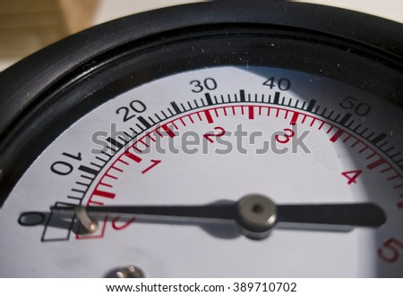 Dial the air pressure gauge with a measuring scale - stock photo