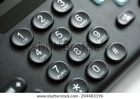 Dialing telephone keypad concept for communication, contact us and customer service support - stock photo
