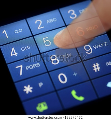 Dialing using touch screen of modern smart phone - stock photo