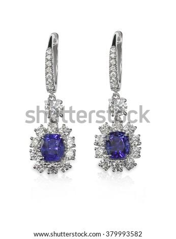 Diamond and Blue Sapphire or tanzanite earrings set with diamonds - stock photo