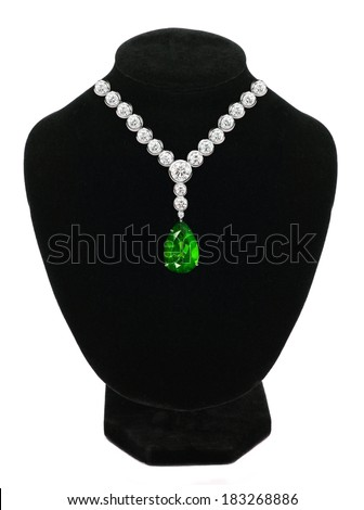 Diamond and emerald necklace on black mannequin isolated on white background - stock photo
