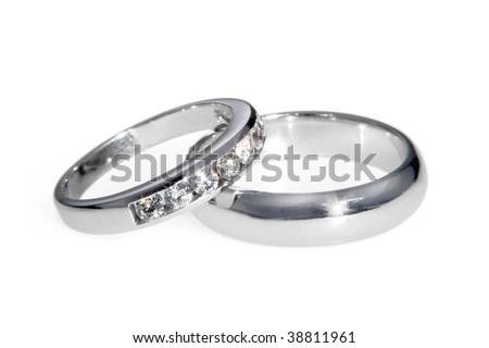 Diamond and white gold bride and groom wedding bands (rings), isolated on white.